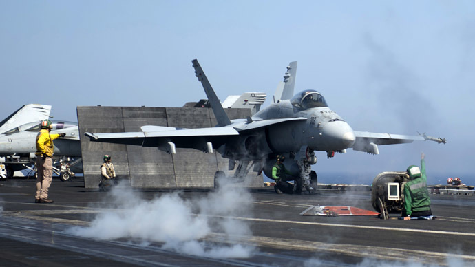 A picture released by the US Navy shows an F/A-18C Hornet assigned to the Rampagers of Strike Fighter Squadron (VFA) 83 preparing to launch from the flight deck of the aircraft carrier USS Dwight D. Eisenhower (CVN 69) on June 17, 2013 in the Mediterranean Sea. (AFP Photo/US Navy)