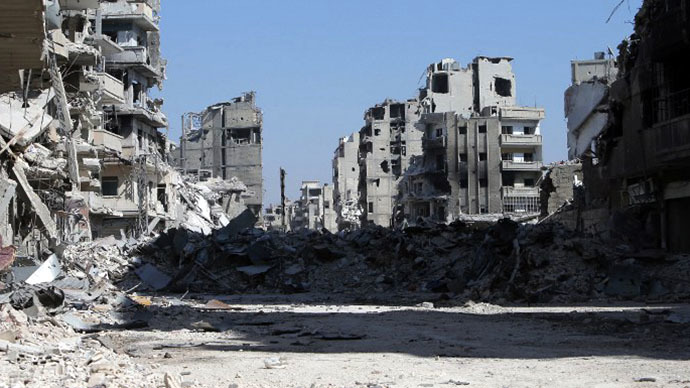 A picture taken on July 31, 2013 shows a devastated street in the Khalidiyah district of Syria's central city of Homs. The Syrian government announced the capture of Khalidiyah, a key rebel district in Homs, Syria's third city and a symbol of the revolt against President Bashar al-Assad. (AFP Photo / Joseph Eid)