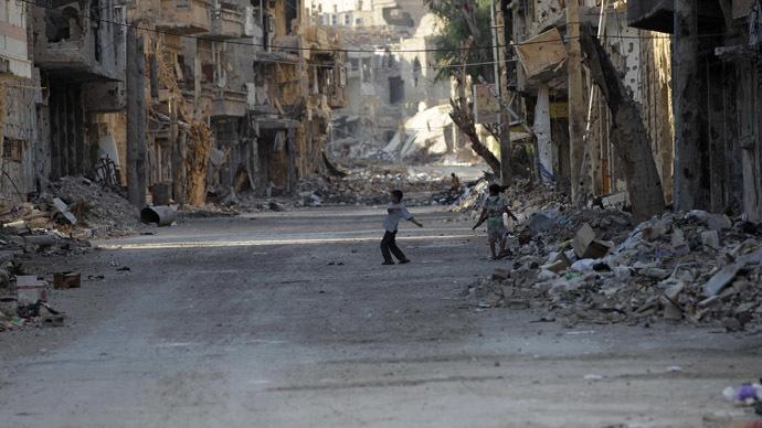Children play at a damaged street in Deir al-Zor August 30, 2013. Picture taken August 30, 2013. (Reuters/Khalil Ashawi)