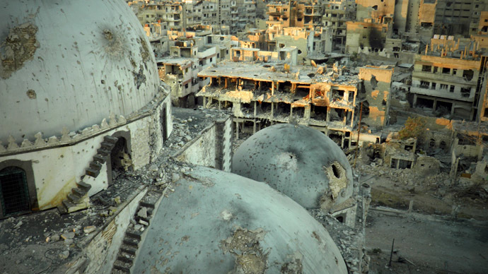 A handout image released by the Syrian opposition's Shaam News Network on July 25, 2013, allegedly shows the Khaled bin Walid mosque whose mausoleum has been partially destroyed in the al-Khalidiyah neighbourhood of the central Syrian city of Homs. (AFP Photo)