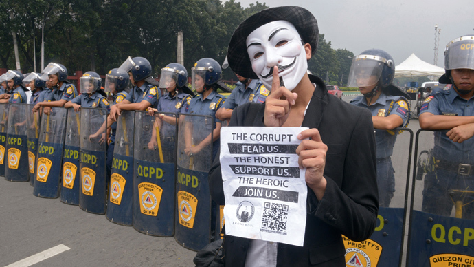 https://img.rt.com/files/opinionpost/21/05/e0/00/anonymous-march-protest-activist.jpg