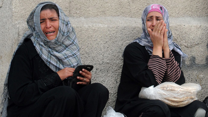 A handout picture released by the Syrian Arab News Agency (SANA) on May 15, 2013, shows protestors crying after unidentified armed groups opened fire on demonstrators as they marched in the Syrian capital Damascus in support of the right to return of Palestinian refugees who fled their homes or were expelled during various conflicts. (AFP/SANA)
