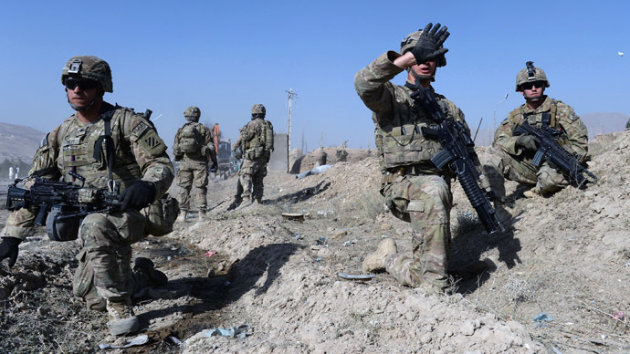 US soldiers stand guard near the site of a suicide attack in Maidan Shar, the capital city of Wardak province south of Kabul on September 8, 2013. (AFP Photo/Shah Marai)