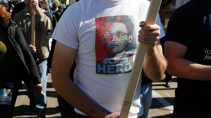 "A demonstrator wears a T-shirt depicting former U.S. spy agency contractor Edward Snowden at the ""Stop Watching Us: A Rally Against Mass Surveillance"" in Washington, October 26, 2013.(Reuters / Jonathan Ernst)"