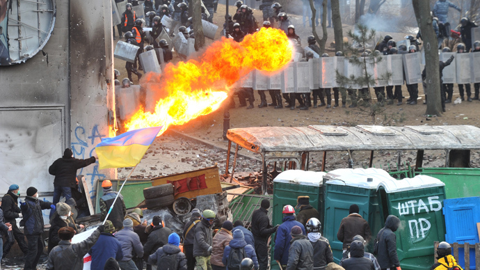 A protester sprays fire in the direction of the riot police during clashes in the centre of Kiev on January 20, 2014 (AFP Photo / Genya Savilov)