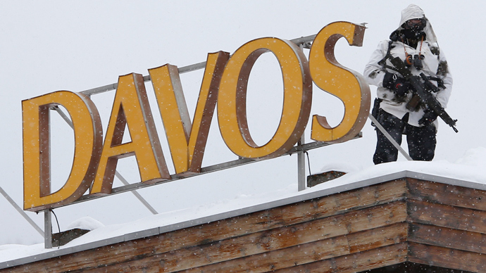 A Swiss special policeman patrols on a roof before the start of the annual meeting of the World Economic Forum (WEF) 2014 in Davos January 21, 2014. (Reuters / Ruben Sprich)