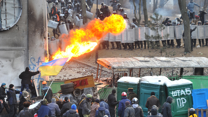 A protester sprays fire in the direction of the riot police during clashes in the centre of Kiev (AFP Photo / Genya Savilov)