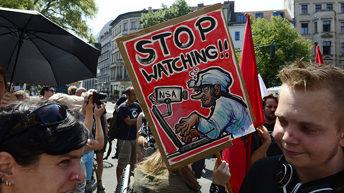 Demonstrators take part in a protest against the US National Security Agency (NSA) collecting German emails, online chats and phone calls and sharing some of it with the country's intelligence services in Berlin (AFP Photo / John Macdougall)