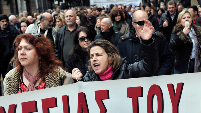 A protester shouts slogans as striking state hospital doctors, health workers and employees of EOPYY, Greece's main healthcare provider, gather outside the Greek Parliament building in Athens to protest government plans to overhaul the primary healthcare sector on February 6, 2014.(AFP Photo / Louisa Gouliamaki)