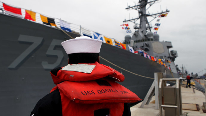 A sailor stands as the USS Donald Cook lays at dock in the southern port of Rota on February 11, 2014.(AFP Photo / Gogo Lobato )