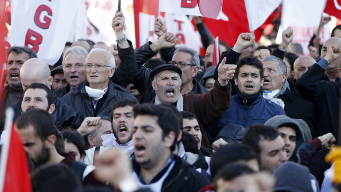 Protesters shout slogans as they try to march towards Turkish Parliament during a protest against Turkey's ruling Ak Party (AKP) and Prime Minister Tayyip Erdogan in Ankara February 13, 2014 (Reuters/Umit Bektas)