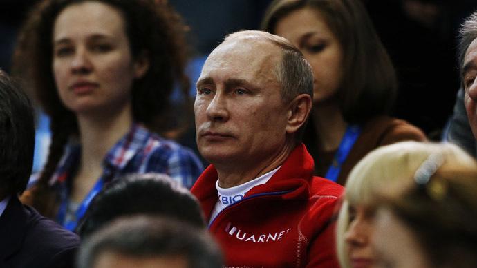 Russian President Vladimir Putin watches from the stands during the Team Ladies Free Skating Program at the Sochi 2014 Winter Olympics, February 9, 2014. (Reuters/Alexander Demianchuk)