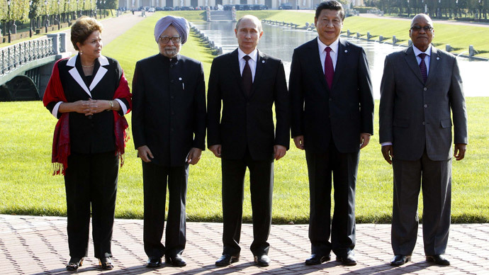 Brazil's President Dilma Rousseff, India's Prime Minister Manmohan Singh, Russia's President Vladimir Putin, China's President Xi Jinping and South African President Jacob Zuma pose for a photo after the BRICS leader's meeting at the G20 summit on September 5, 2013 in Saint Petersburg.(AFP Photo / Sergei Karpukhin )