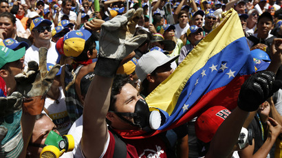 Opposition supporters shout during a rally against Venezuela's President Nicolas Maduro's government in Caracas March 22, 2014. (Reuters)