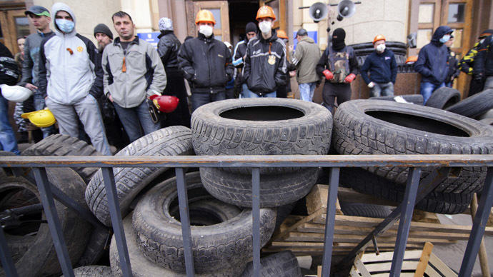 Pro-Russian protesters gather outside the regional administrative building, with automobile tyres seen in the foreground, in the eastern city of Kharkiv April 7, 2014. (Reuters)