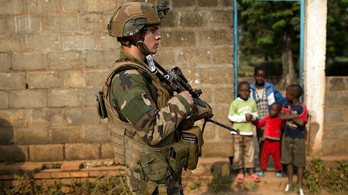 A French peacekeeping soldier patrols a street of the capital Bangui, CAR January 18, 2014 (Reuters / Siegfried Modola)