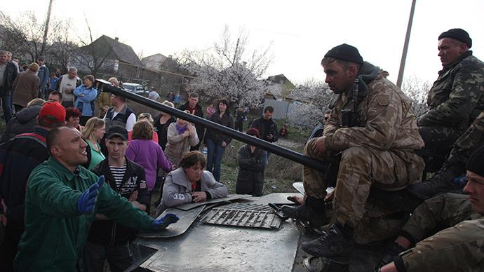 Ukraine must solve crisis itself to avoid bloodshed, IMF debt slavery