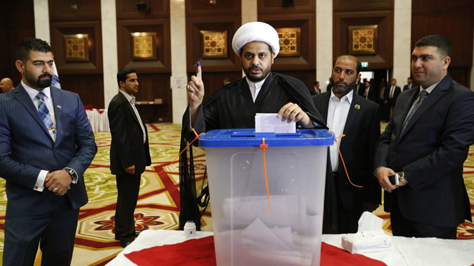 Sheik Qais Khazaali, leader of the militant group Asaib Ahl Haq, shows his ink-stained finger as he votes during a parliamentary election in Baghdad April 30, 2014. (Reuters)