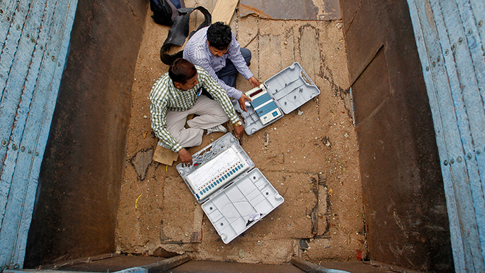 Polling officials check electronic voting machines in a truck after collection them at a distribution centre in the northern Indian city of Allahabad May 6, 2014 (Reuters / Jitendra Prakash)