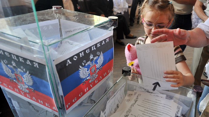 A girl casts a ballot in a polling station during a so-called referendum in the eastern Ukrainian city of Donetsk on May 11, 2014. (AFP Photo/Genya Savilov)