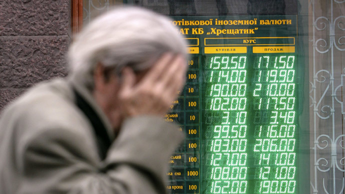A man walks past a currency exchange office in Kiev, April 10, 2014. (Reuters/Valentyn Ogirenko)
