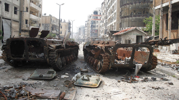 The wreckage of armoured personnel carriers belonging to the forces loyal to Syria's President Bashar al-Assad are seen at al-Hamdeya neighborhood in Homs city May 9, 2014.(Reuters / Khaled al-Hariri )