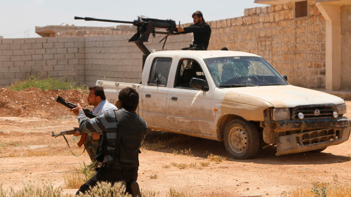 A Free Syrian Army fighter mans an anti-aircraft gun on the back of a pick-up truck during clashes with forces loyal to Syria's President Bashar al-Assad in Sheikh Najjar in Aleppo May 13, 2014. (Reuters / Hosam Katan)