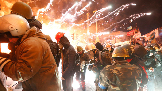 Fireworks explode near anti-government protester during clashes with riot police at the Independence Square in Kiev February 18, 2014.(Reuters / Vasily Fedosenko )