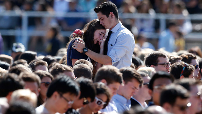 Students console one another at the University of California Santa Barbara's Harder Stadium during a memorial service in honor of the victims of Friday's Isla Vista rampage in Santa Barbara, California, May 27, 2014. (Reuters / Lucy Nicholson)