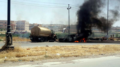 Burning vehicles belonging to Iraqi security forces are seen during clashes between Iraqi security forces and al Qaeda-linked Islamic State in Iraq and the Levant (ISIL) in the northern Iraq city of Mosul, June 10, 2014.(Reuters / Stringer)