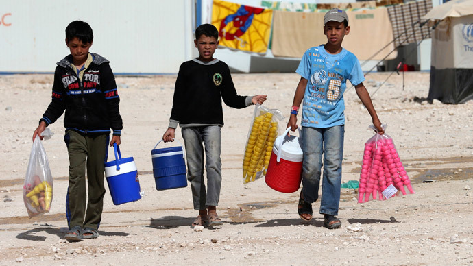 Syrian refugee children sell ice cream at Al Zaatri refugee camp in the Jordanian city of Mafraq, near the border with Syria.(Reuters / Muhammad Hamed )
