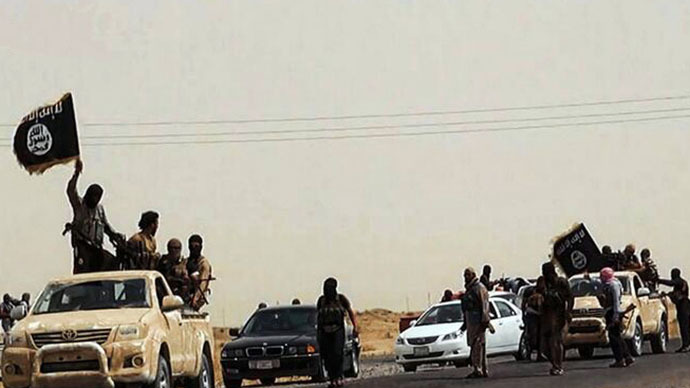 An image uploaded on June 14, 2014 on the jihadist website Welayat Salahuddin allegedly shows militants of the Islamic State of Iraq and the Levant (ISIL) driving on a street at unknown location in the Salaheddin province. (AFP Photo)