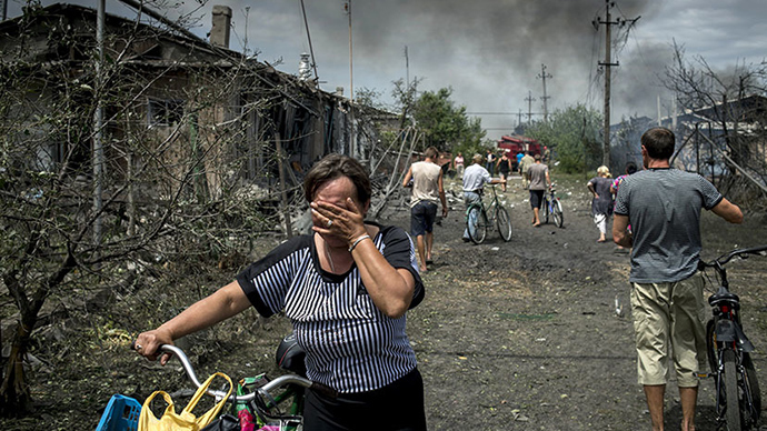 The site of the second strike by Ukrainian military on densely-populated residential areas in the Lugansk Region looked even worse than the first. Nine people died and 11 were wounded in the attack, said the head of the local administration, Vladimir Bilous (RIA Novosti / Valeriy Melnikov)
