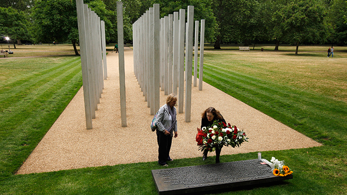 Jolie Nicholson (L), whose daughter Jennifer died in the 7/7 bombings, and Frances Macleod of the Department of Culture, deliver flowers from Britain's Prime Minister David Cameron at the London Bombing Memorial on the fifth anniversary of the attacks, at Hyde Park in London July 7, 2010 (Reuters)