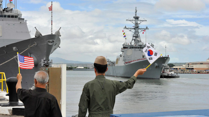 Pastor Park Jong-soo (L) and South Korea's Navy Cmdr. Kim Jung-tae wave to the crew of South Korea's navy destroyer Seoae Ryu Seong-ryong (DDG 993) as the ship departs Joint Base Pearl Harbor-Hickam in Hawaii, in preparation for the sea phase of the Rim of the Pacific (RIMPAC) Exercise 2014 in this July 7, 2014 picture provided by the U.S. Navy.(Reuters / Martin Wright)
