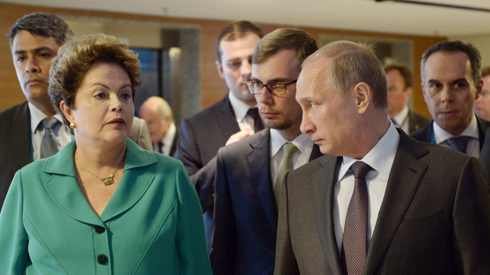 Brazil's President Dilma Rousseff (L) and Russia's President Vladimir Putin arrive for the 2014 FIFA World Cup final football match between Germany and Argentina at the Maracana Stadium in Rio de Janeiro on July 13, 2014. (AFP Photo / Aleksey Nikolskyi)