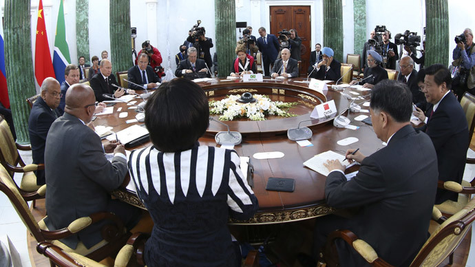 Leaders sit at a table before the BRICS summit in Saint Petersburg on September 5, 2013. (AFP Photo / Pool / Sergei Karpukhin