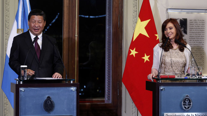 China's President Xi Jinping (L) speaks next to his Argentine counterpart Cristina Fernandez de Kirchner at the Casa Rosada government palace in Buenos Aires July 18, 2014. (Reuters/Enrique Marcarian)