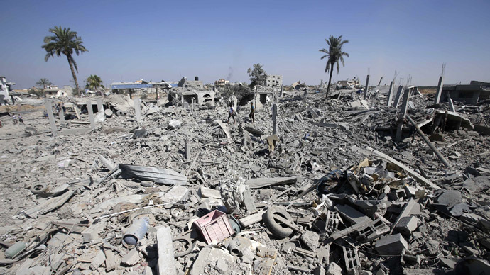 Palestinians walk among the rubble of destroyed houses in the east of Khan Younis, which witnesses said was heavily hit by Israeli shelling and air strikes during an Israeli offensive, in the southern Gaza Strip August 1, 2014. (Reuters)