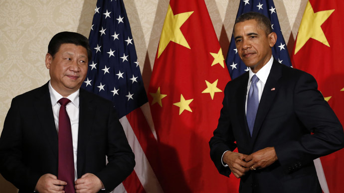 U.S. President Barack Obama (R) meets China's President Xi Jinping, on the sidelines of a nuclear security summit, in The Hague March 24 2014. (Reuters)