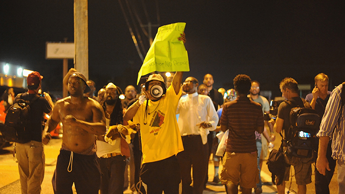 Protesters march during a peaceful protest on West Florissant Ave. in Ferguson, Missouri on August 19, 2014 (AFP Photo / Michael B. Thomas)