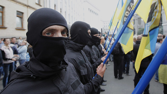 "Members of Ukrainian self-defence battalion ""Azov"" march in support of soldiers that protesters say are surrounded in eastern Ukraine by pro-Russian separatists, in front of the Presidential Administration office in Kiev, August 27, 2014. (Reuters / Valentyn Ogirenko)"