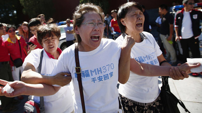 Family members of passengers onboard the missing Malaysia Airlines Flight MH370, cry as they gather to pray Yonghegong Lama Temple in Beijing September 8, 2014, on the six-month anniversary of the disappearance of the plane. (Reuters)