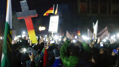 "Participants hold up their mobile phones during a demonstration called by anti-immigration group PEGIDA, a German abbreviation for ""Patriotic Europeans against the Islamization of the West"", in Dresden December 8, 2014. (Reuters/Hannibal Hanschke)"