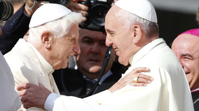 Pope Francis (R) greets Emeritus Pope Benedict XVI before a mass in Saint Peter's square at the Vatican September 28, 2014. (Reuters/Tony Gentile)