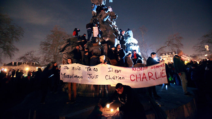 "People take part in a Unity rally ""Marche Republicaine"" on January 11, 2015 at the Place de la Nation (Nation square) in Paris in tribute to the 17 victims of a three-day killing spree by homegrown Islamists. (AFP Photo / Loic Venance)"