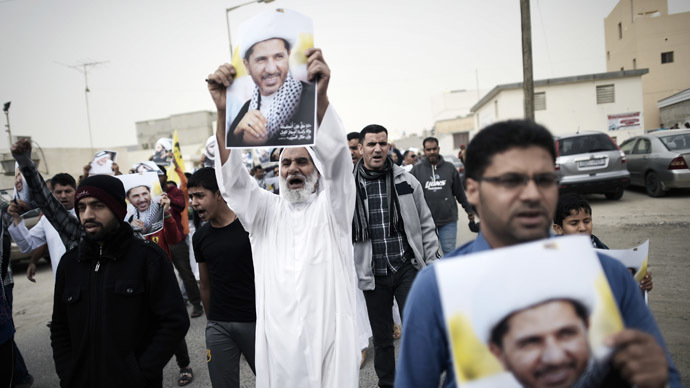 Bahraini men take part in a protest against the arrest of Sheikh Ali Salman (on the posters), head of the Shiite opposition movement Al-Wefaq on January 9, 2015 in the village of Karzakan, South of Manama. (AFP Photo/Mohammed Al-Shaikh)