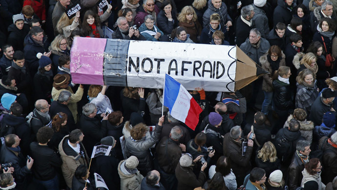 "Citizens carrying a giant cardboard pencil reading ""Not Afraid"" take part in a Hundreds of thousands of French citizens solidarity march (Marche Republicaine) in the streets of Paris January 11, 2015. (Reuters/Charles Platiau)"