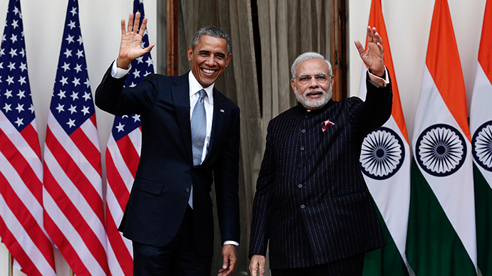 U.S. President Barack Obama and India's Prime Minister Narendra Modi (R) wave during a photo opportunity ahead of their meeting at Hyderabad House in New Delhi January 25, 2015 (Reuters / Adnan Abidi)