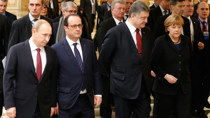 Russia's President Vladimir Putin (L, front), Ukraine's President Petro Poroshenko (2nd R, front), Germany's Chancellor Angela Merkel (R, front) and France's President Francois Hollande (2nd L, front) walk during peace talks in Minsk, February 11, 2015.(Reuters / Vasily Fedosenko)